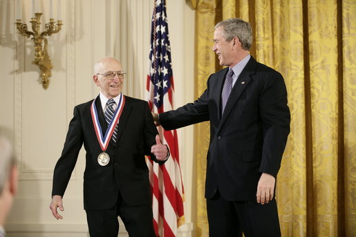 President George W. Bush presents a National Medal of Technology, Monday, Feb. 13, 2006 to Ralph H. Baer of Manchester, N.H., during ceremonies in the East Room of the White House. Baer was honored for his groundbreaking and pioneering creation, development and commercialization of interactive video games. White House photo by Eric Draper
